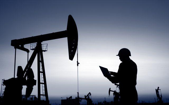 Workers on tablet in Oil field